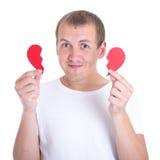 Miłości pojęcie - szczęśliwy mężczyzna trzyma dwa halfs złamane serce Obraz Royalty Free
