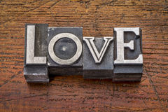 Miłości słowo w metalu typ Fotografia Royalty Free