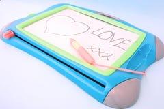 Miłości wiadomość na desce Fotografia Royalty Free