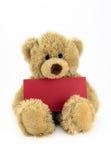 Miś pluszowy z czerwoną kartką. Obraz Royalty Free