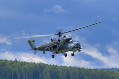 Mi-24 hind. Heavy military helicopter hovering over the forrest Stock Images