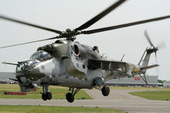 Mi-24 Hind attack helicopter. LIEGE-BIERSET, BELGIUM - MAY 13: Russian build Czech Air Force Mi-24 Hind attack helicopter take off on the Bierset Heli-meet May Royalty Free Stock Photo