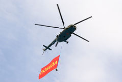 Mi-8 helicopter with Victory banner Stock Photo