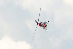 Mi-2 demonstrates aerobatics. ZHUKOVSKY, RUSSIA - AUGUST 12: Mi-2 light helicopter demonstrates aerobatics during the celebration of the centenary of Russian Air Royalty Free Stock Photos
