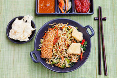 Mi goreng,mee goreng Indonesian cuisine, spicy stir fried noodles and assortment of asian sauces Top view Stock Photos