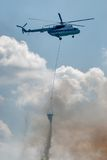 MI-8 helicopter flies for fire extinguishing Stock Photography