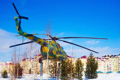 The MI-8 helicopter at the pedestal on  background of  city in winter. Royalty Free Stock Photos