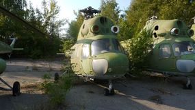 Mi-2 helicopters are on long-term preservation. Mi-2 helicopters in the long-term Parking lot.The green color of the helicopters.Parking of aircraft stock photography