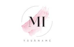 MI M I Watercolor Letter Logo Design con el modelo circular del cepillo Foto de archivo libre de regalías