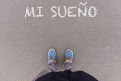 Mi sueno, Spanish text for My Dream text on asphalt ground, feet Royalty Free Stock Photography
