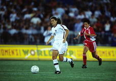 Mia Hamm USA Soccer Player. Mia Hamm bringing up the soccer ball up field to her teammates royalty free stock images