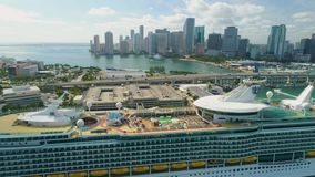 Miami aerial view buildings boats Miami river and down town. Aerial view port of Miami and down town showing cruise ships buildings convention centers and arenas stock footage