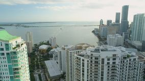 Miami aerial view buildings boats Miami River Brickell and down town. Aerial View Port of Miami and Down Town Brickell Showing Cruise Ships stock footage