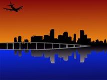 Miami au coucher du soleil avec l'avion Photographie stock