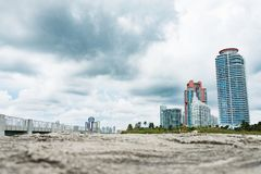 Miami beach buildings and skyscraper during cloudy day from the pier Royalty Free Stock Images