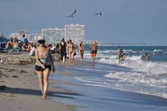 Miami Beach casual landscape. People sunbathing and walking on South Beach, Miami, Florida Royalty Free Stock Photos