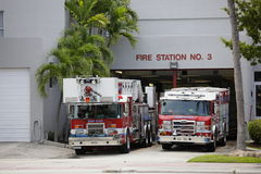 Miami Beach fire department. MIAMI BEACH - AUGUST 10: Image of Miami Beach fire Station number 3 with two fire trucks parked outside ready for action August 10 stock photos