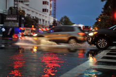 MIAMI BEACH, FL - JULY 18: Cars moving on flooded streets and roads of Miami South Beach  after heavy rains Stock Photo