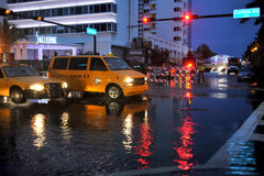 MIAMI BEACH, FL - JULY 18: Cars moving on flooded streets and roads of Miami South Beach  after heavy rains Royalty Free Stock Images