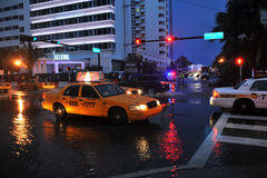 MIAMI BEACH, FL - JULY 18: Cars moving on flooded streets and roads of Miami South Beach  after heavy rains Stock Photography