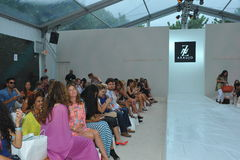 MIAMI BEACH, FL - JULY 21: Guests attend the A.Z Araujo show. During Mercedes-Benz Fashion Week Swim 2015 The Raleigh on July 21, 2014 in Miami Beach, Florida stock photo