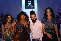 MIAMI BEACH, FL - JULY 21: (L-R) TV personality Adriana De Moura, designer A.Z Araujo and model/business woman Cozete Gomes walk t Stock Photo