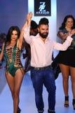 MIAMI BEACH, FL - JULY 21: (L-R) TV personality Adriana De Moura, designer A.Z Araujo and model/business woman Cozete Gomes walk t Royalty Free Stock Photo