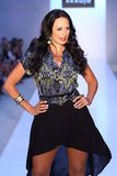 MIAMI BEACH, FL - JULY 21: Model/Business woman Cozete Gomes walks the runway at the A.Z Araujo show Stock Photos