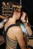 MIAMI BEACH, FL - JULY 21: A model prepares backstage at the A.Z Araujo show Stock Image
