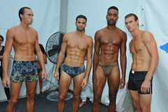 MIAMI BEACH, FL - JULY 21: Models pose backstage at the A.Z Araujo show Stock Images