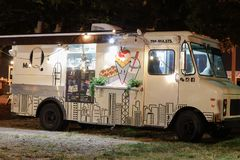 Night image of food trucks in a park 4. MIAMI BEACH, FL, USA - DECEMBER 26, 2017: Night image of a food truck gathering in Haulover Park kite field royalty free stock photography