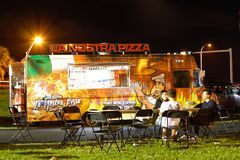 Night image of food trucks in a park 2. MIAMI BEACH, FL, USA - DECEMBER 26, 2017: Night image of a food truck gathering in Haulover Park kite field stock photos