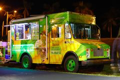Night image of food trucks in a park. MIAMI BEACH, FL, USA - DECEMBER 26, 2017: Night image of a food truck gathering in Haulover Park kite field stock photography