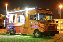 Night image of food trucks in a park. MIAMI BEACH, FL, USA - DECEMBER 26, 2017: Night image of a food truck gathering in Haulover Park kite field royalty free stock images
