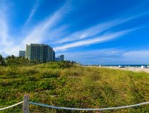 Miami Beach in Florida with luxury apartments and waterway. Miami Beach in Florida with luxury apartments and green grass near waterway Royalty Free Stock Image