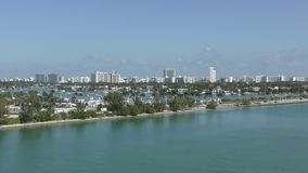 Miami beach Florida. Miami Beach seen in zoom out view from the Port of Miami stock video