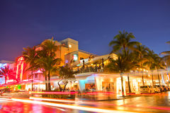 Miami Beach, Florida. USA-April 5, 2013:Illuminated hotels and restaurants at sunset on Ocean Drive, world famous destination for nightlife, beautiful weather Royalty Free Stock Photo