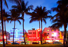 Miami Beach, Florida. USA-April 5, 2013:Illuminated hotels and restaurants at sunset on Ocean Drive, world famous destination for nightlife, beautiful weather Stock Photos