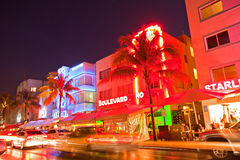 Miami Beach, Florida. USA-April 5, 2013:Illuminated hotels and restaurants at sunset on Ocean Drive, world famous destination for nightlife, beautiful weather Royalty Free Stock Photos