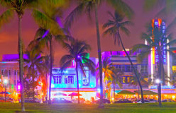 Miami Beach. Florida USA-August 16, 2013:Illuminated hotels and restaurants at sunset on Ocean Drive, world famous destination for nightlife, beautiful weather Royalty Free Stock Images