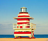 Miami Beach Florida, USA. Famous tropical travel location, typical Art Deco lifeguard house on a beautiful summer afternoon with ocean and blue sky Royalty Free Stock Photo