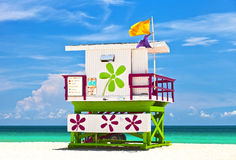 Miami Beach Florida, USA famous tropical travel location. Typical Art Deco lifeguard house on a beautiful summer day with ocean and blue sky Royalty Free Stock Photo