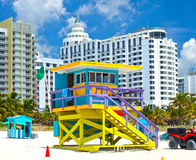 Miami Beach Florida, USA famous tropical travel location. Typical Art Deco lifeguard house and hotels on a beautiful summer day Royalty Free Stock Images