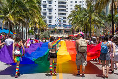 Miami Beach Gay Pride Parade Flag Behind. The 6th Annual Miami Beach Gay Pride Parade, along Ocean Drive in Miami Beach, Florida on April 13th, 2014. Lesbian stock photo