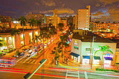 Miami Beach Lincoln Road Mall Movie Theater and moving traffic. Miami Beach, Florida USA-November 13, 2015: Lincoln Road Mall Movie Theater and moving traffic on Royalty Free Stock Photography