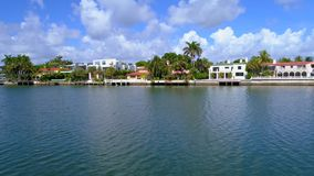 Miami Beach mansions 4k 60p. Aerial low footage of Miami Beach mansions on Indian Creek stock video footage