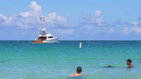 Miami beach ocean swimmers summer day yacht view 4k usa stock video