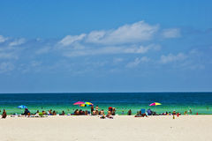 Miami beach with people enjoying the ocean Royalty Free Stock Photos