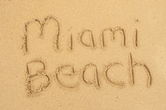 Miami Beach. A picture of the words Miami Beach drawn in the sand Royalty Free Stock Images