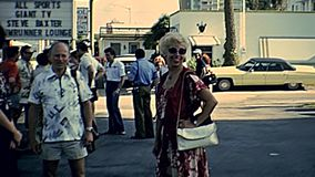Miami Beach 1970s tourists. Miami Beach, Florida, United States - Circa 1978: Miami Beach tourists in mall parking with vintage clothes on holiday in 70`s stock footage